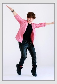 JAX MALCOLM PINK SHIRT DANCING ON TOES.jpg